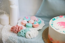 pink and turquoise macaroons and delicate jewelry made of chiffon. beautiful desserts for decoration and celebration. home pastry shop.