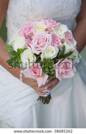 stock photo Pink and white rose wedding bouquet held by bride