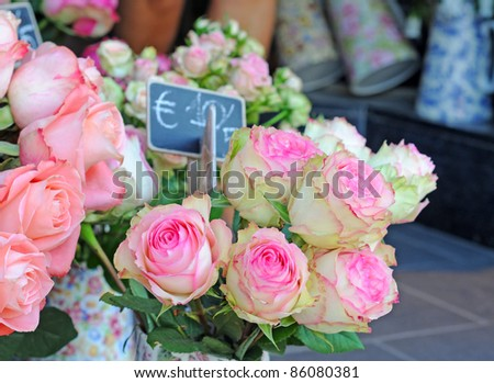 Pink and white roses on the market place, shallow depth of field