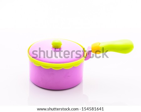 Pink and yellow Child plastic pot cooking toy - stock photo