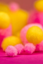 pink and yellow fluffy  Pom Poms