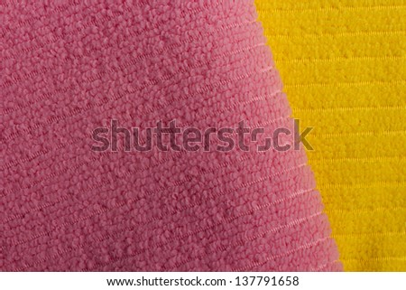 Pink and yellow terry towels as a background.
