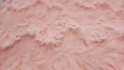 Pink artificial fur fabrics, nun when touch