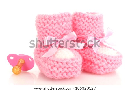 pink baby boots and pacifier isolated on white