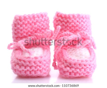pink baby boots isolated on white - stock photo