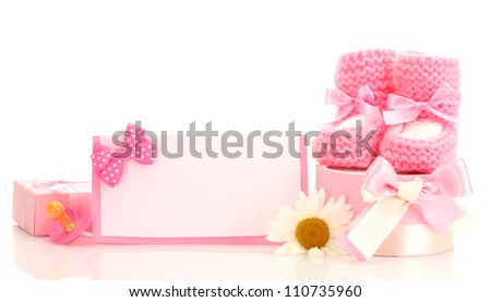 pink baby boots, pacifier, gifts, blank postcard and flower isolated on white