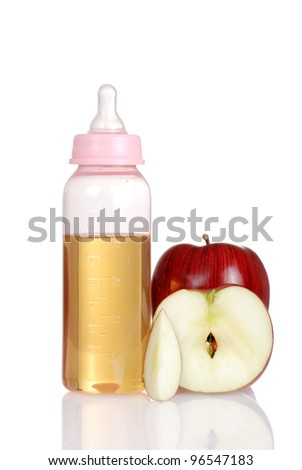 Pink baby bottle with fresh apple juice