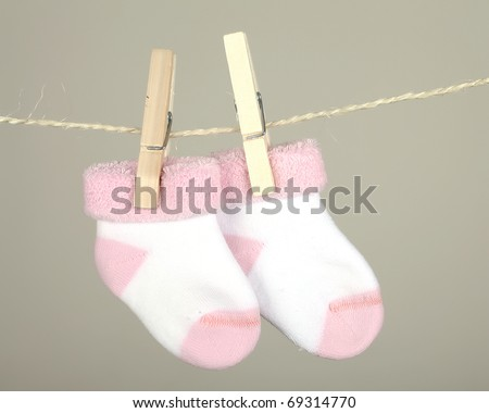 pink baby sock hanging on the clothesline