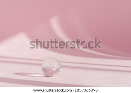 Pink background for product presentation with shadows and light from windows. Pink backdrop with transparent sphere decor, display, mockup. Window natural shadow overlay effect on pink surface