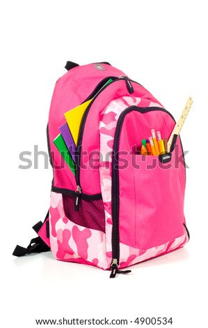 Pink backpack with school supplies on white background with folders, pens, a ruler and glue