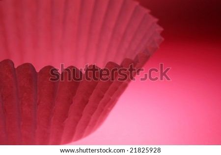 pink baking cup against a pink background