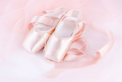 Pink ballet shoes close-up. New pink ballet pointe shoes.