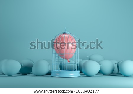 Shutterstock Pink balloon floating in white cage on blue background. minimal idea concept.