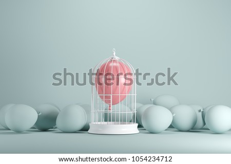 Pink balloon floating in white cage on pastel green background. minimal idea concept.