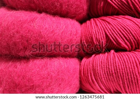 Pink balls of wool in cotton and mohair quality.