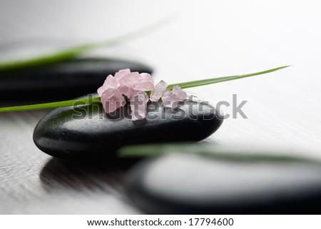 Pink bath salt on black stone