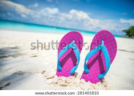 Pink beach flip flops and on tropical sand beach Thailand