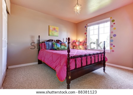 pink bed in girls bedroom