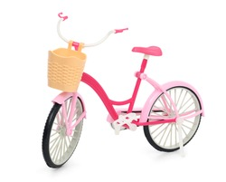 Pink bicycle with a basket isolated on a white background. Bicycle toy for girls