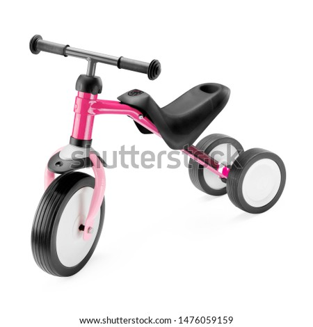 Pink Black Baby Balance Bike Isolated on White. Children's 3 Wheeled Sliding Vehicle. Modern Kids Three Wheels Tricycle Bicycle Side View. Cycling Toddler Training Trike Bike. Infant Walker Scooter