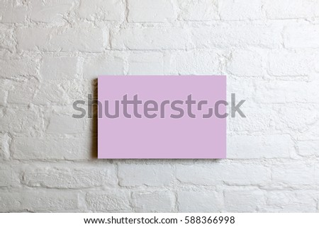 Pink blank poster in a white brick wall. Template Mock up for your content. #588366998