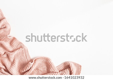 Pink blanket on white background. Flat lay, top view Stockfoto ©
