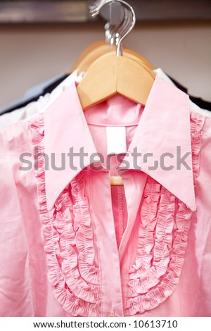 pink blouse hanging in a retail store