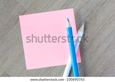 Pink blue post-it note with colorful pencils