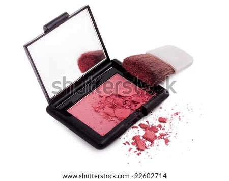 Pink blush with brush and mirror isolated on white
