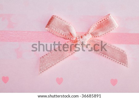 pink bow on background with hearts