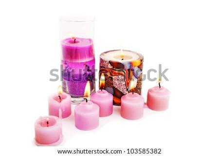 Pink burning candles isolated on white background.