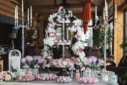 Pink candy bar for holiday celebration. Sweet buffet for birthday party or wedding at banquet hall. Desserts assortment, catering concept