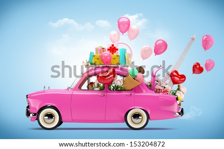 Pink car with symbols of love. Unusual Valentine's day background