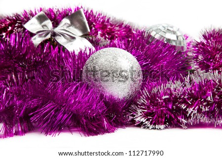 Pink christmas decorations on white background