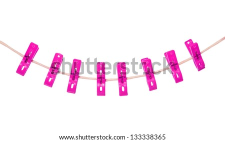 pink clothespin hang on rope (clothesline) isolated on white background
