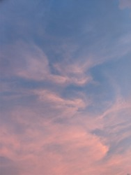 pink cloud in blue sky