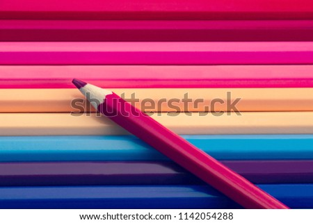 pink color pencil on many colorful pencils background, pastel colours tone