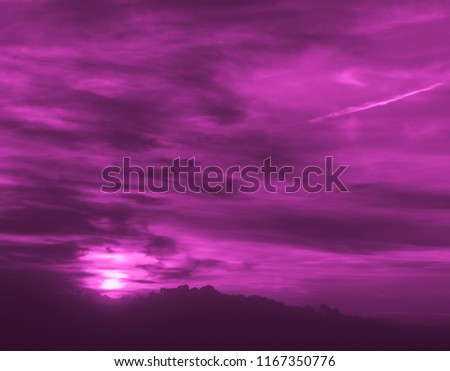 Pink colored clouds and the sun at sunset. Colorful landscape #1167350776