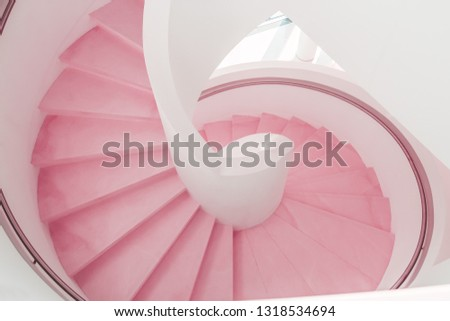 Pink coral modern spiral staircase descent #1318534694