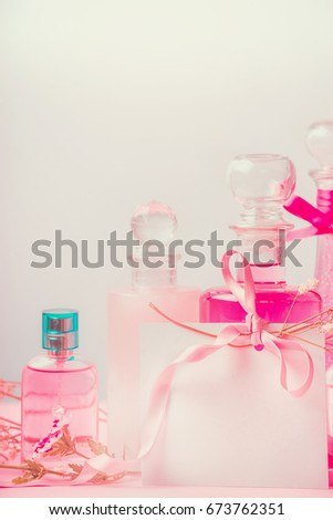 Pink cosmetic products set in bottles at pastel background, front view. Beauty and skin care concept on pastel background, front view