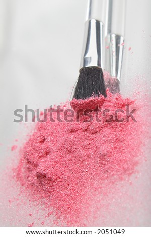 Pink cosmetic shimmer powder, vertical format with applicator brush