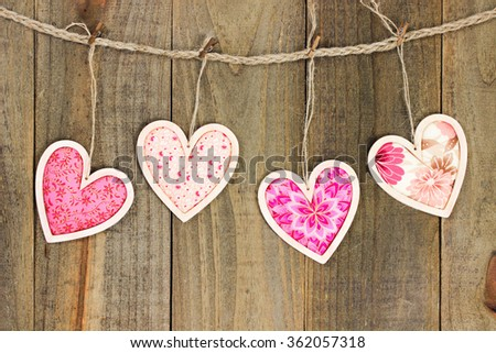 Pink Country Fabric Hearts Hanging On Clothesline With Antique Rustic Wood Door Valentines Day