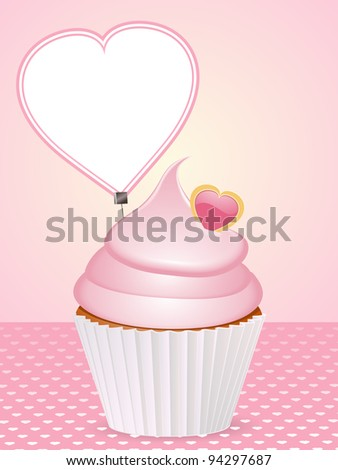 pink cupcake with heart shaped message label on a pink background