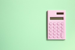 Pink digital calculator on green background