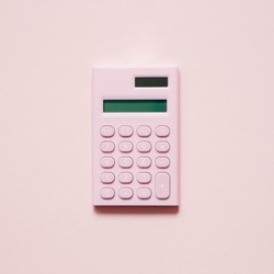 Pink digital calculator on pink background