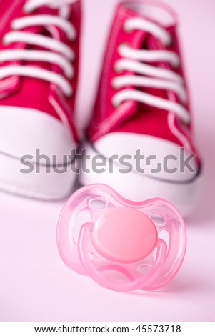 Pink dummy and cute baby shoes #45573718