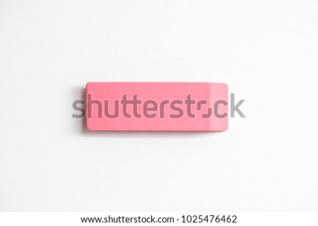 Pink eraser shot up close against a white background - Shutterstock ID 1025476462