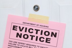 Pink Eviction Notice Taped on Front Door Close Up.
