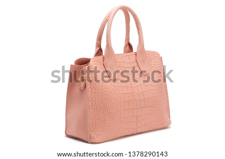 Pink female handbag with reptile pattern