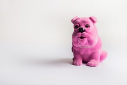 pink figurine dog with white background